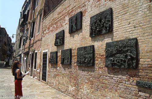 Venice Jewish ghetto - A woman observes the headstones in memory of the victims of the nazism - Una donna osserva le lapidi in memoria dei deportati del nazismo